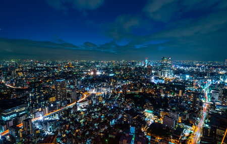 Asia Business concept for real estate and corporate construction - panoramic urban city skyline aerial night view with twilight sky in Tokyo, Japan