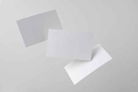 Design concept - front view of 3 surreal white business card float on mid air isolated on white background 版權商用圖片