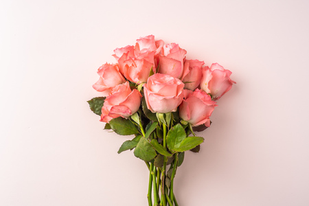 event design concept - top view of a bunch of pink rose on pink background for mothers day and valentines day, wedding event with copy space for mock up Stock Photo