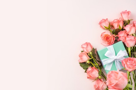 event design concept - top view of a bunch of pink rose and gift box on pink background for mothers day and valentines day, wedding event with copy space for mock up Stock Photo