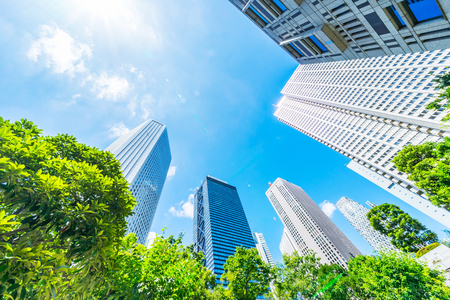 Asia Business concept for real estate, corporate construction and ecology - looking up view of panoramic modern city skyline with blue sky and green tree in shinjuku, tokyo, japan Фото со стока - 120771199
