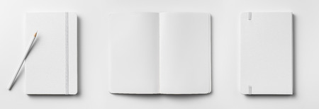 Top view of open and close white notebook with elastic band, blank page and wooden pencil isolated on white background Stockfoto