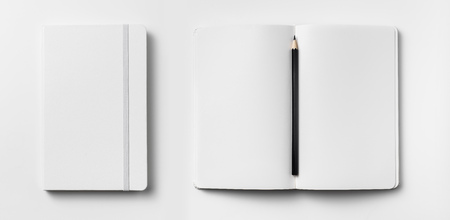 Top view of open and close white notebook with elastic band, blank page and wooden pencil isolated on white background