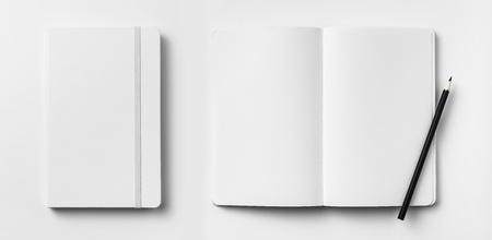 Top view of open and close white notebook with elastic band, blank page and wooden pencil isolated on white background 写真素材