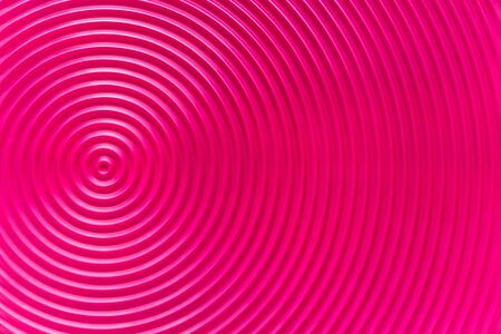Design concept - abstract pink plastic concentric circle texture background, not 3d render