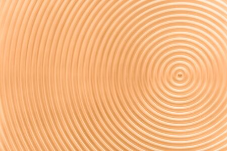Design concept - abstract yellow plastic concentric circle texture background, not 3d render