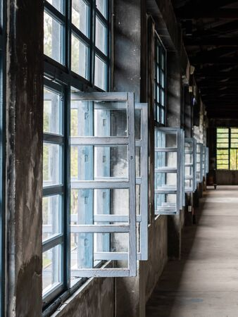vintage factory interior with glass window and aisle