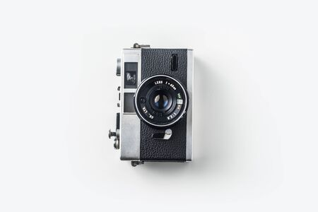 Top view of vintage cameras on white background desk for mockup