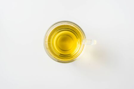 Top view of glass cup of hot tea on white background desk for mockup