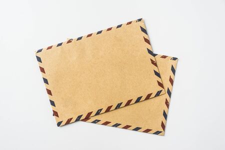 Top view of 2 post envelope isolated on white background desk for mockup Фото со стока