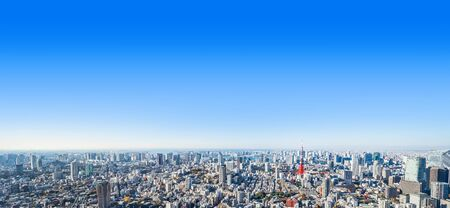 Asia Business concept for real estate and corporate construction - panoramic modern city skyline bird eye aerial view of tokyo tower and odaiba under blue sky in Roppongi Hill, Tokyo, Japan