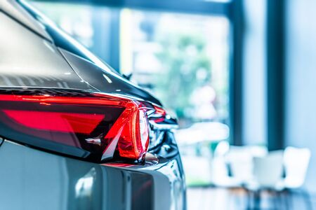 rear view of new modern silver car led tail lights in showroom