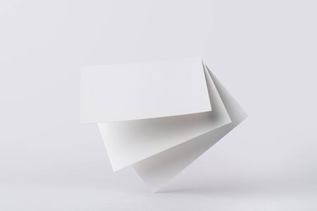 Floating blank business cards on white background Stock Photo