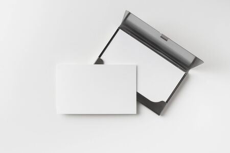 Design concept - top view of horizontal business card with stainless steel case isolated on white background Stock Photo