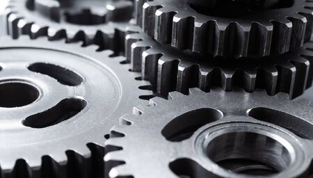Teamwork business concept - perspective view of engine gear wheel, for industrial background