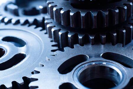 Concepto de negocio de trabajo en equipo - vista en perspectiva de la rueda dentada del motor, para el fondo industrial Foto de archivo