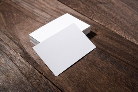 Design concept - top view of white business cards on wood floor background Stock Photo