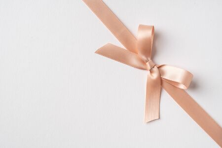 Design concept - top view of pink bow isolated on white background for mockup