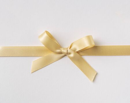 Design concept - top view of yellow bow isolated on white background for mockup Stockfoto
