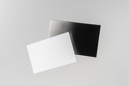 Design concept - top view of horizontal business card with stainless steel case float in the air and isolated on white background for mockup, it's real photo, not 3D render 写真素材 - 129894939