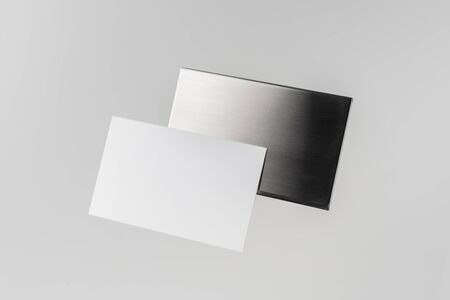 Design concept - top view of horizontal business card with stainless steel case float in the air and isolated on white background for mockup, it's real photo, not 3D render 写真素材 - 129894943