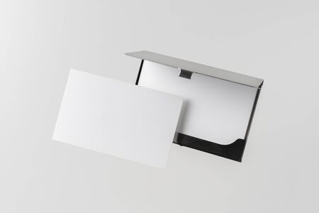 Design concept - top view of horizontal business card with stainless steel case float in the air and isolated on white background for mockup, it's real photo, not 3D render 写真素材 - 129895066