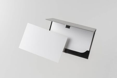 Design concept - top view of horizontal business card with stainless steel case float in the air and isolated on white background for mockup, it's real photo, not 3D render 写真素材 - 129895111