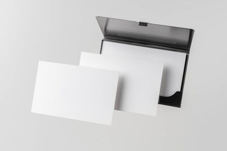 Design concept - top view of horizontal business card with stainless steel case float in the air and isolated on white background for mockup, it's real photo, not 3D render 写真素材 - 129895115