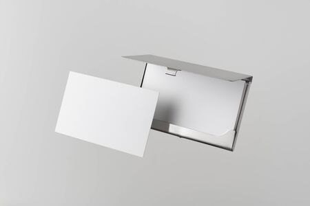 Design concept - top view of horizontal business card with stainless steel case float in the air and isolated on white background for mockup, it's real photo, not 3D render 写真素材 - 129895693