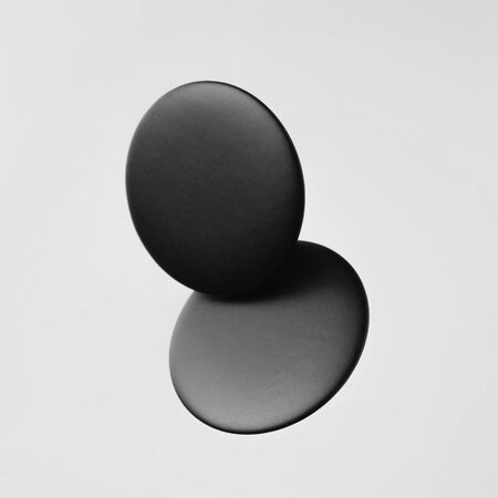 Design concept - top view of 2 black badge float on white background for mockup, it's real photo, not 3D render