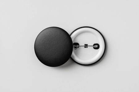 Design concept - top view of 2 front & back black badge isolated on white background for mockup, its real photo, not 3D render
