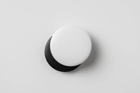 Design concept - top view of 2 black & white badge isolated on white background for mockup, its real photo, not 3D render
