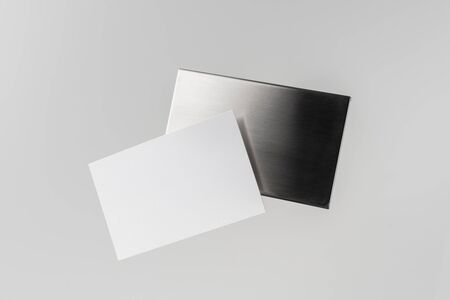 Design concept - top view of horizontal business card with stainless steel case float in the air and isolated on white background for mockup, it's real photo, not 3D render 写真素材 - 133594206