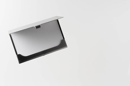 Design concept - top view of horizontal business card with stainless steel case float in the air and isolated on white background for mockup, its real photo, not 3D render