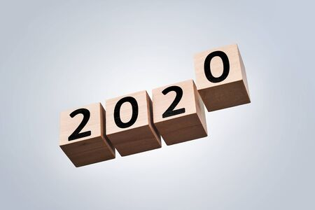 Business and design concept - surreal abstract geometric floating wooden cube with word 2020 concept isolated on background 写真素材
