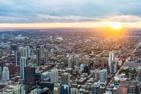 Business concept for real estate and corporate construction - panoramic urban city skyline aerial view under bright sky and beautiful sunset in Chicago, America 写真素材