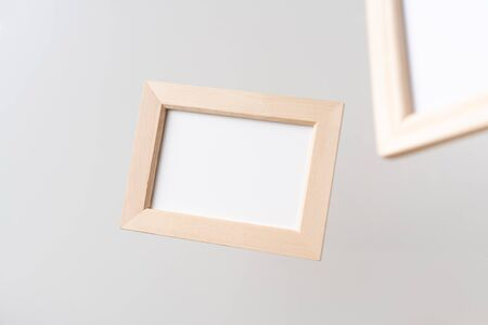 Design concept - top view of two brown wood photo frame float on mid air with blur effect isolated on white background for mockup, it's real photo, not 3D render Фото со стока - 140959291