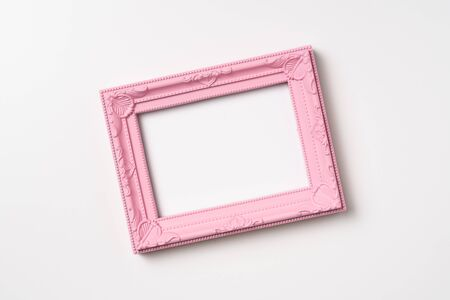 Design concept - top view of pink vintage wood photo frame isolated on white background for mockup, its real photo, not 3D render Фото со стока
