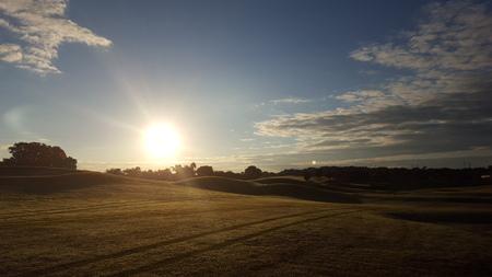 日の出ゴルフ コース 写真素材