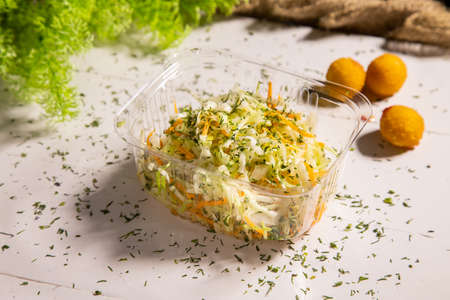 Fresh healthy salad - cabbage, carrot and olive oil Archivio Fotografico