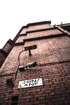 CCTV Cameras mounted on building in manchester UK security system watched followed monitoring