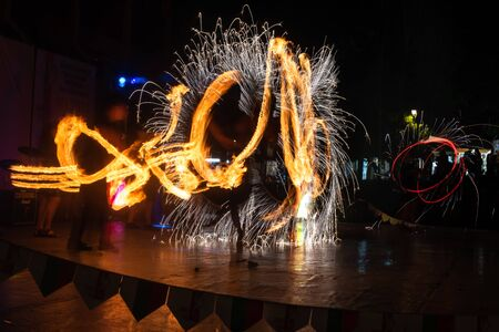 Fire Show Flaming Trails on stage slow shutter exciting event concept Reklamní fotografie