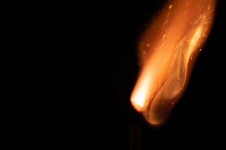 Ignition of match with sparks isolated on black background 스톡 콘텐츠