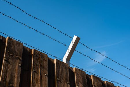 barbed wire wooden fence border war crysis news blue sky vivid