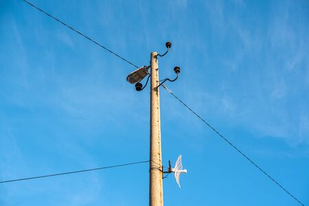 Electric pole telephone cable post sky blue clouds