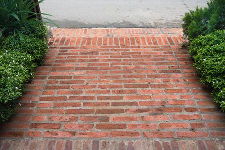 Old brick paving on a sidewalk Luang prabang , Laos 免版税图像