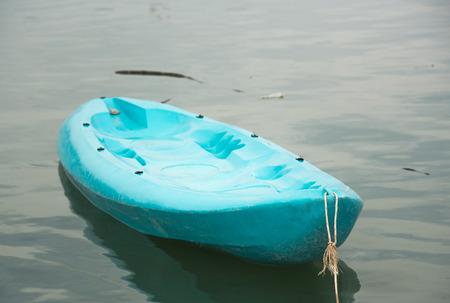 Blue cano boat on sea
