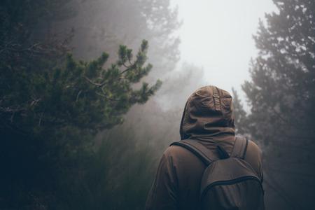 mood: man walking in forest