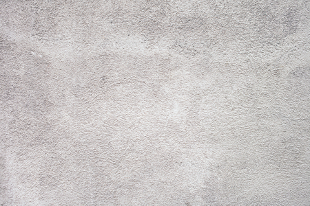 Grungy white concrete wall background. Background from high detailed fragment stone wall. Cement texture. Grey concrete wall. Zdjęcie Seryjne