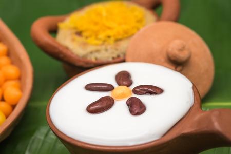 clay pot: Sweet Thai dessert in clay pot Stock Photo